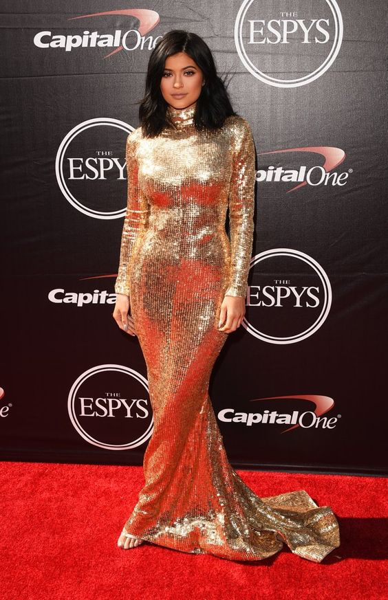 Pin for Later: The Stars at the ESPYs Were Definitely on Their Style Game Kylie Jenner Kylie Jenner glistened in gold when she walked the red carpet in a turtleneck floor-length gown by Lebanese designer Shady Zeineldine.