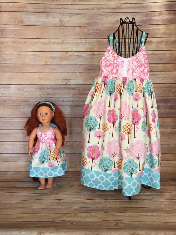 A personal favorite from my Etsy shop https://www.etsy.com/listing/293633175/dolly-and-me-pink-paisley-flutter-dress