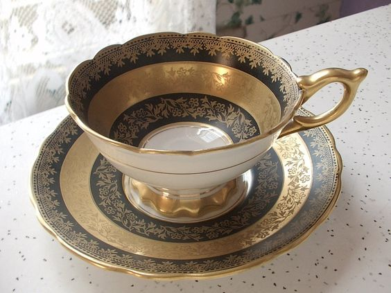 Vintage black and gold tea cup.