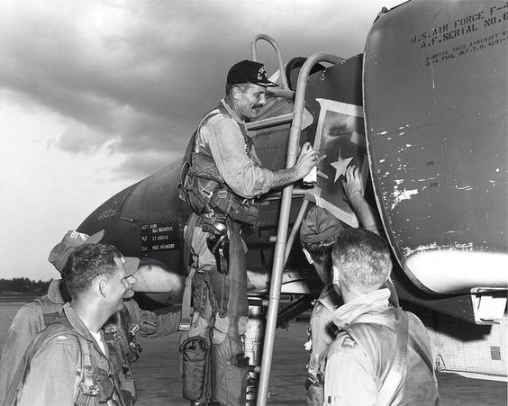"Col. Robin Olds painting a victory star on the McDonnell F-4 ""Phantom"" he was flying on May 4, 1967, when he shot down a MiG-21."