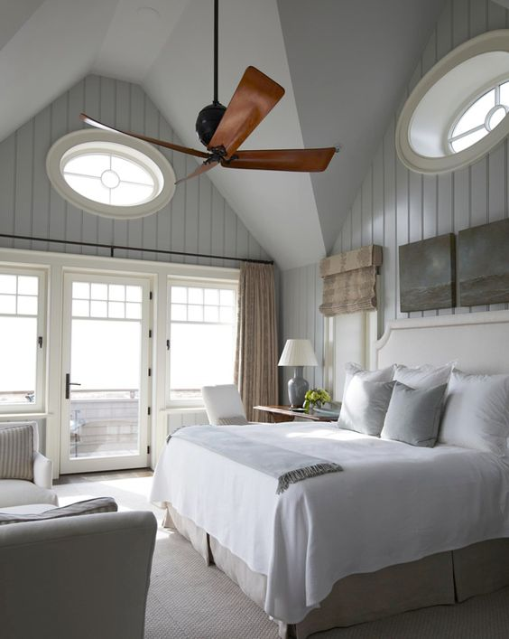 The neutral palette in this master bedroom is perfectly soothing. The ocean views and beach-front balcony are a bonus. - Traditional Home ® / Photo: Colleen Duffley / Design: Tammy Connor: