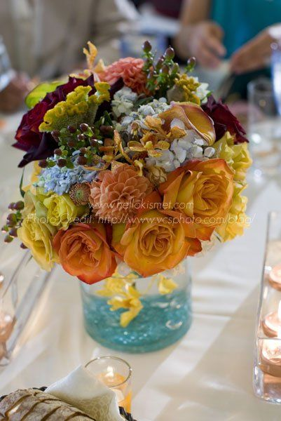 Who else is loving these summer colors?  This floral centerpiece is sure to be the talk of the table!    xoxo Kismet Events