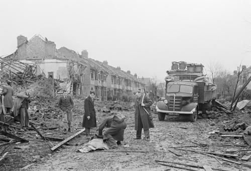 Rescue workers searching through the damaged town to identify the dead after a Luftwaffe bombing; Coventry, England - 15 November 1940 Photo by George Rodger