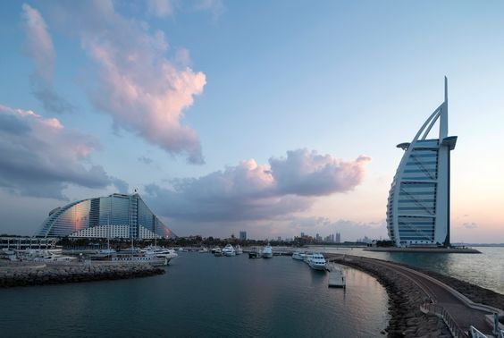 The warm waters of the Arabian Gulf lap at your legs as you sit on powder-white sand. To your left the glorious Burj Al Arab rises out of the sea like a ship hewn from light, its billowing sail-lik...
