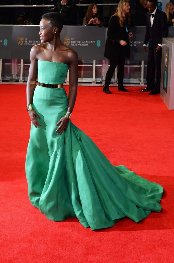 Lupita Nyong'o in Christian Dior Fall 2013 Couture gown, Ana Khouri gold 'Ildeman' cuffs and gold-and-pearl 'Laura' earrings and Christian Louboutin shoes – 2014 BAFTAs