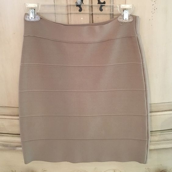 BCBGMaxAzria Bandage Skirt BCBG Bandage Skirt - Beautiful neutral tan, which goes with any color top and any pair of shoes. Worn one time, in excellent condition. BCBGMaxAzria Skirts Midi