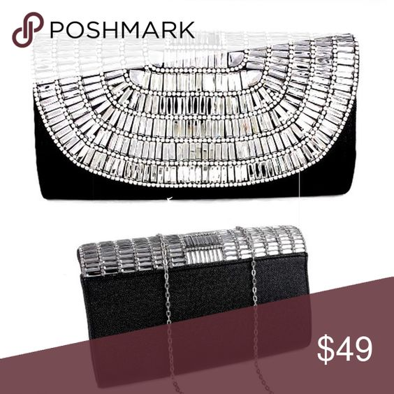 Black w Crystals Clutch Purse Black front and back, silver crystals of flap, the clutch is hard not soft and floppy, the picture shows colors in crystals however they are all of clear silver w no color discoloration. Includes chain boutique Bags Clutches & Wristlets