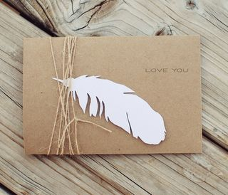 paper feather and twine on kraft envelope