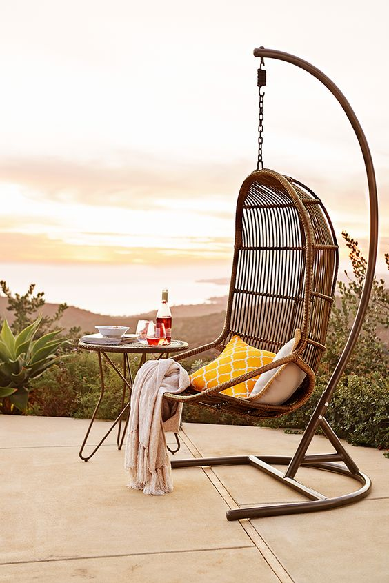 We could go on and on about the durability of the Pier 1 Swingasan®—made of wrought iron and synthetic rattan—but we all know the key feature is that it's just fun to hang out in one.