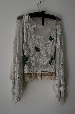 .This gives me ideas for fabulous appliques over net fabric or even lace.