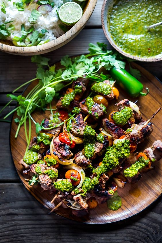 Grilled Chilean Beef Skewers with Smoky Chimichurri Sauce and Cilantro Rice. An easy flavorful weeknight meal.   www.feastingathome.com