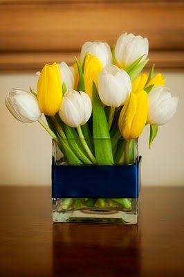 Fresh and cute tulip spring centerpiece for wedding reception