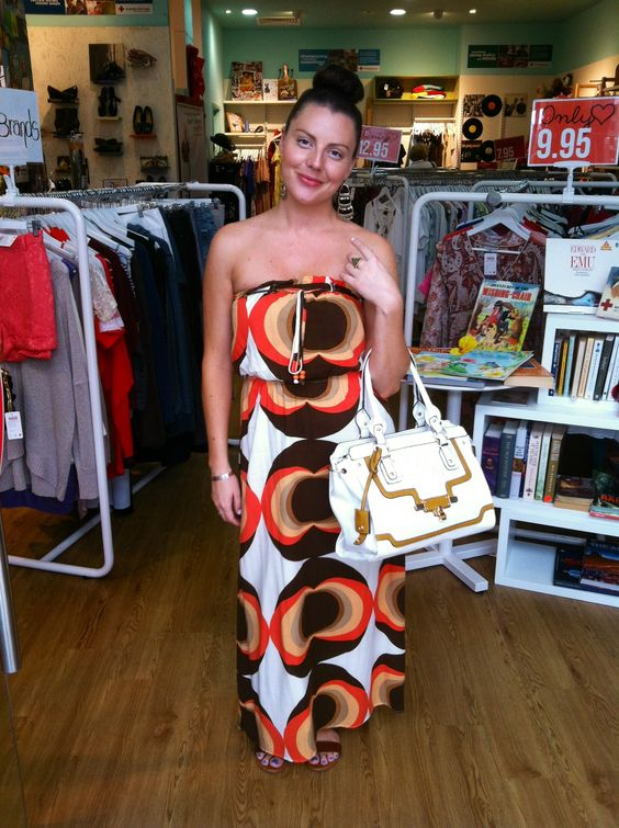 Store manager Jodie, from Charlestown Sq store wears retro inspired maxi dress purchased at her store! For only $19.95. Alongside the handbag for only $39.95.