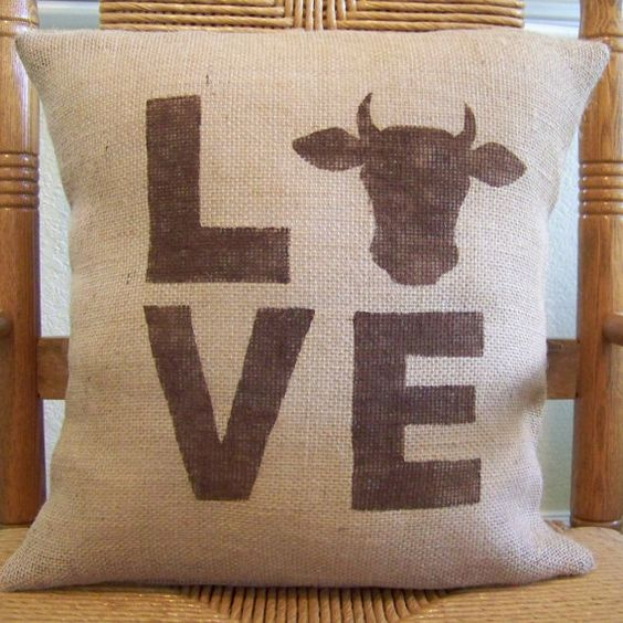 Our decorative burlap pillow cover is sure to add the perfect country farm house feel to your home. Made from natural burlap fabric. The cow silhouette and lettering is hand stenciled onto each cover from a hand cut stencil . The cover that is shown in photo is in brown and can be made in different colors to match your décor. *Burlap is made from a plant which may cause natural imperfections, I always do my best to work around blemishes when possible. Paints adhere differently to burlap than...