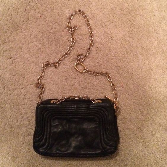 Black Crossbody Faux leather with gold chain accent strap, two section pockets-front and back. Bags Crossbody Bags
