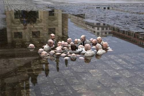 """This sculpture by Issac Cordal in Berlin is called """"Politicians discussing global warming.""""    This sculpture by Issac Cordal in Berlin is called """"Politicians discussing global warming."""""""