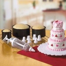 Kitchen: Mini Tiered Cake Baking Set 3 Pans &7 Decorating Tips & 1 Decorating Plunger Seller: JCstore.biz -- Roses in a Row starting at $14