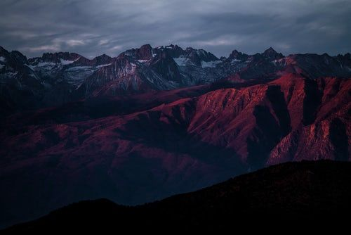 A Red Hued Shot Of A Mountainous Landscape With Numerous Snow Capped Peaks Mountain Wallpaper Dark Wallpaper Mountain Pictures