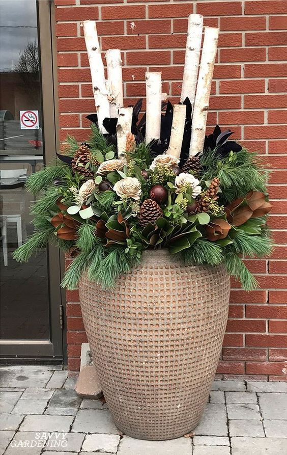 garden pot with floral arrangement and big logs #christmas  #containers #planters #gardenplanters #Log #birch  #pinecones
