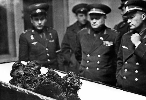 The charred remains of Russian cosmonaut Vladimir Komarov, who died in a suicide space mission because no one dared to tell Soviet leader Leonid Brezhnev that it would fail.