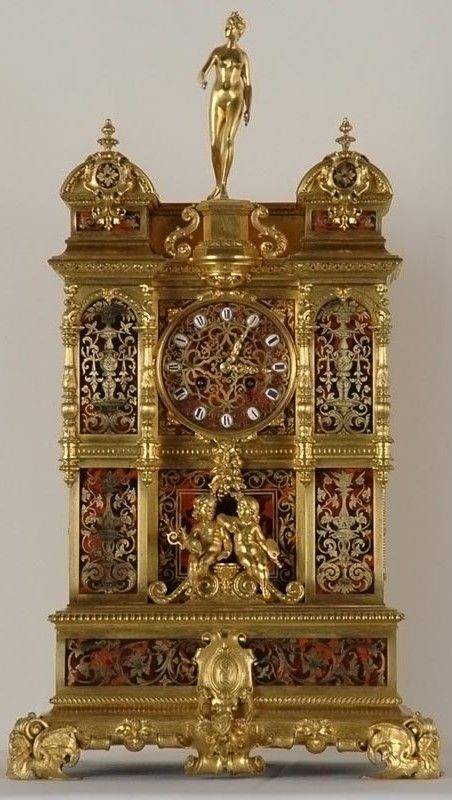 Antique Clocks :     Goddess Diana Clock made in Paris 1870s Conceived as a miniature architecture with two pediments directly in the center, this clock was produced in gilded bronze and translucent red enamel which gives it extravagance and luxury. The decorations seem to imitate the Boulle...
