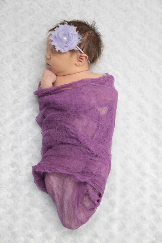 Newborn pictures with cheesecloth