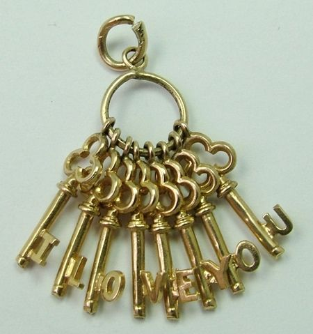 A 1970s English 9ct gold charm of a bunch of keys that spell out 'I LOVE YOU', hallmarked for 1971.: