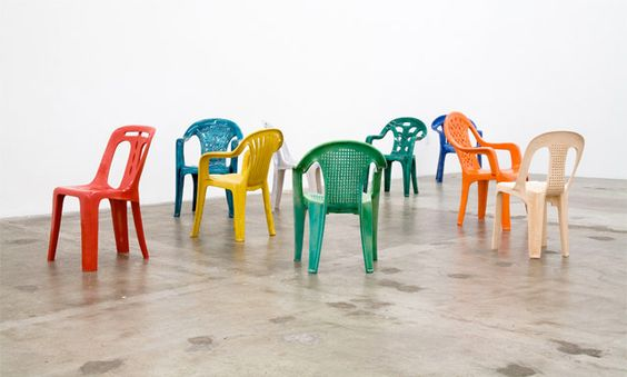 Porcelain chairs by Sam Durant, reproductions of different styles of mono-block resin chairs.