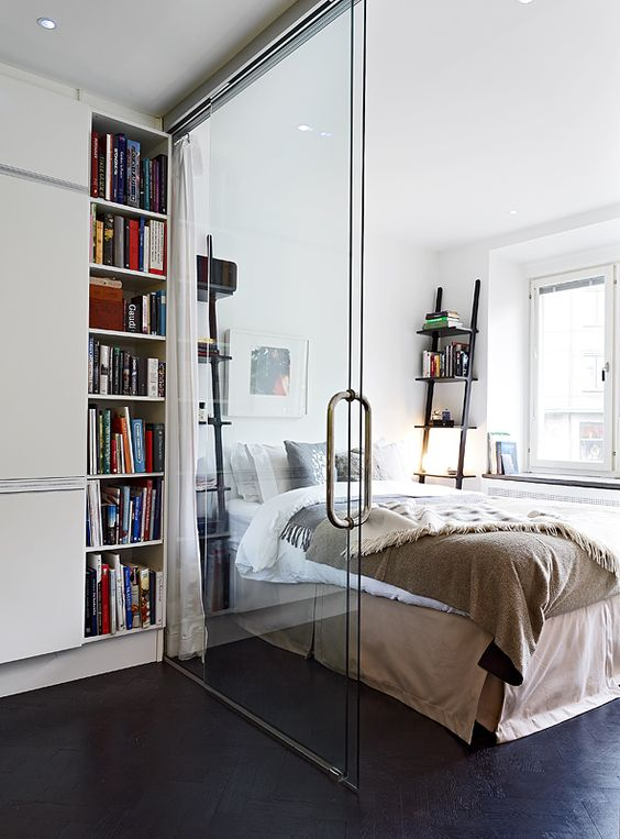 Furnishing Small Apartment glass wall divider in a small apartment separating kitchen and