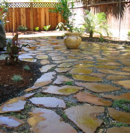 Urbanite (broken concrete chunks) patio stained with iron sulfate.
