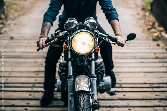 Man on motorcycle outside.   Isaiah & Taylor Photography for Stocksy United