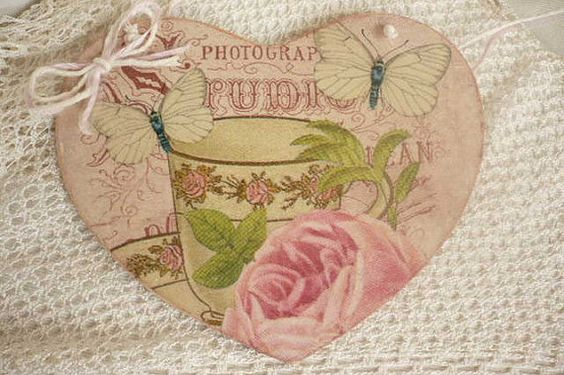 Vintage style heart decorated with deoupage