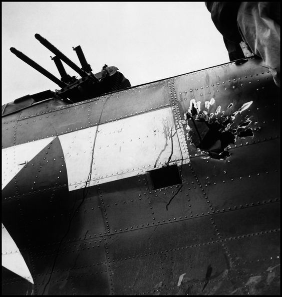 SOUTH PACIFIC. November 5th, 1943 on board the US aircraft carrier USS Saratoga. This hole cost a man's life. The gunner in this Navy bomber was killed by a 20mm shell from a Japanese...