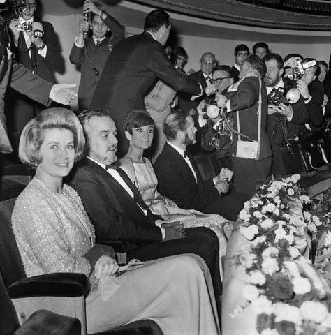 Princess Grace and Prince Rainier of Monaco and actors Audrey Hepburn and Mel Ferrer, (left to right), attend a charity gala at the Marigny Theater here. The gala was given to raise funds for the building of a home for aged movie actors. (1965)