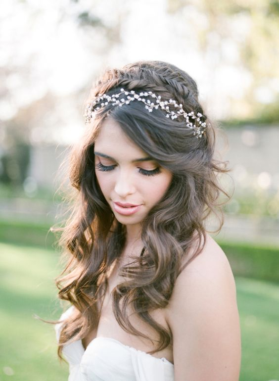 Braided half up half down wedding hairstyle with vine More