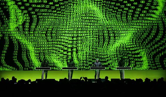 German electronic band Kraftwerk performs in front of a 3D projection during the 47th Montreux Jazz Festival in Montreux