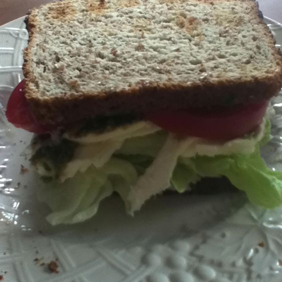 Mozzarella sandwich with pesto, lettuce and tomatoes. Garlic philidelphia is great instead of butter og something like that.