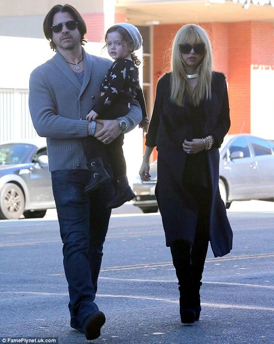 Trendy arrival: Rachel Zoe made a stunning fashion statement as she arrived to the Baby2Baby Holiday Party alongside her husband Rodger Berman and two-year-old son Skyler, in Los Angeles on December 14, 2013.