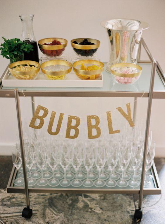 A bubbly bar cart: http://www.stylemepretty.com/massachusetts-weddings/salem-ma/2016/01/06/backyard-seaside-massachusetts-wedding/ | Photography: Charlotte Jenks Lewis - http://charlottejenkslewis.com/