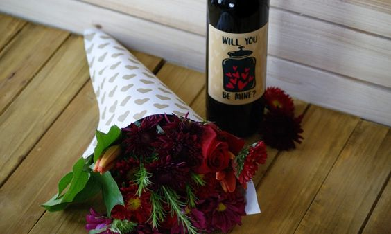Personalized Wine bottle and flowers for Valentine's day http://info.winegreeting.com/blog/personalize-your-valentines-day-gift