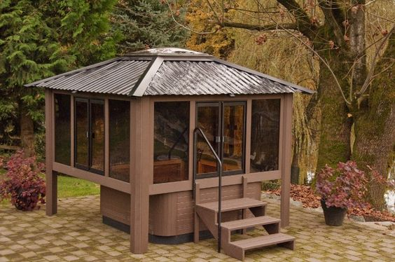 This treehouse style gazebo is definitely fun and it has plenty of doors and glass to experience the outdoors. The metal roof also has plenty to protect you while you're hanging out in the tub.
