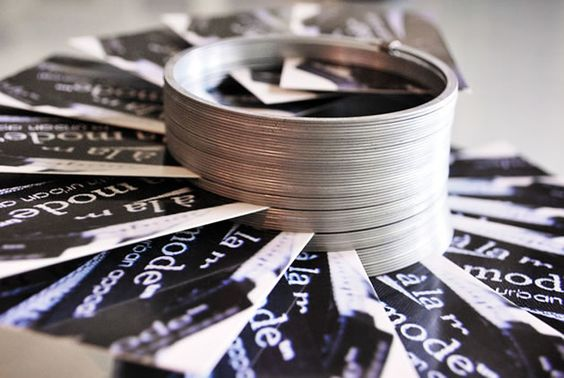 using a slinky as a craft show business card holder