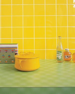 Brighten up your kitchen space with a colorful backsplash. | http://domino.com