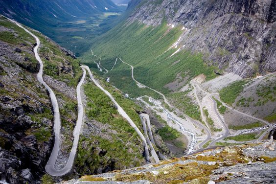 """Trollstigen is a road thru the mountains of Norway's Rauma area that is famous for it's 11 twists & turns as well as for it's steep incline.  The name mean's """"Troll's Ladder"""". It crosses over the Stigfossen waterfall bridge with a viewing platform.  Road closed in winter."""