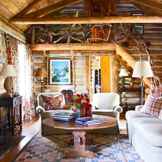 Once Upon A Cabin – Everyday Living.  Love the mixing of patterns and color palette used throughout the house.