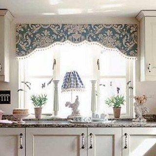 board mounted valance with shaped bottom and trim.