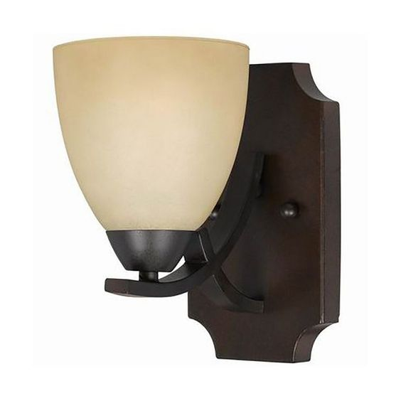 This transitional 1-light wall sconce features a bronze finish that will compliment many transitional decors. The tea stained glass shade softens the light and completes the look.