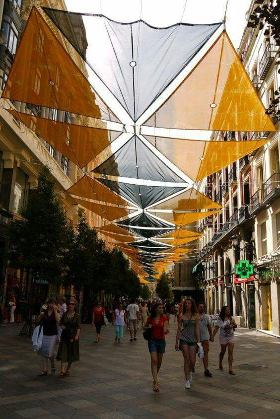 Orange and black canopy over the shopping street Calle del Arenal, Madrid, Spain. -The LA Team www.landarchs.com