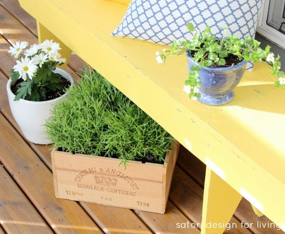 Wine crates and metal buckets repurposed as planters for simple green and white plants. Via @Shauna Oberg @ Satori Design