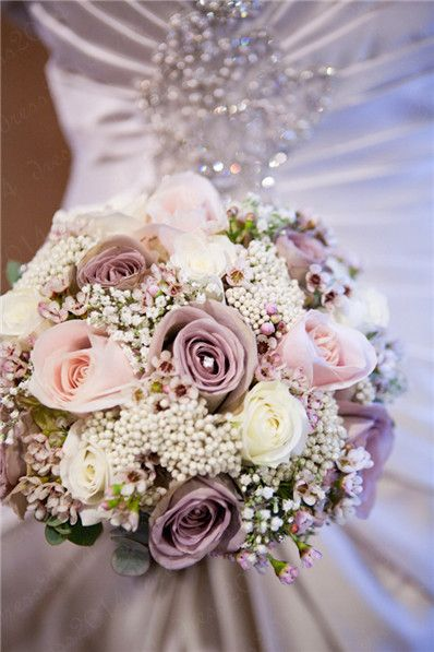 Vintage Gathering Wedding Flowers: Purples, roses, soft neutral colours in a wedding bouquet: